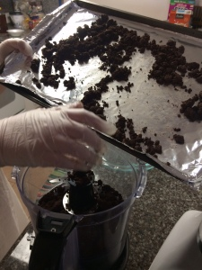 Grind the chocolate brownie crumble in a food processor before molding to your pie plate.